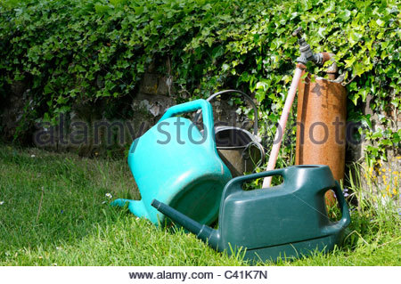 Watering cans and standpipe, Dorset England - Stock Photo