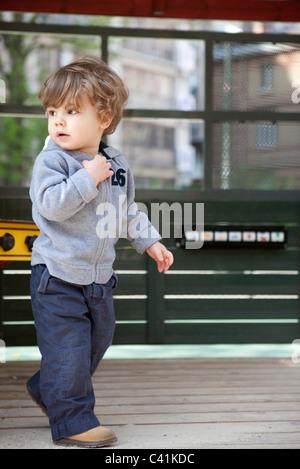 Little boy walking on playground - Stock Photo