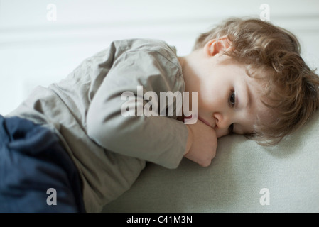 Toddler boy sucking thumb, portrait Stock Photo
