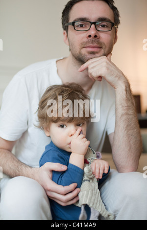 Father and toddler son, portrait - Stock Photo