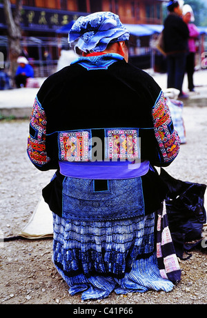 A Miao woman wearing traditional clothing. - Stock Photo