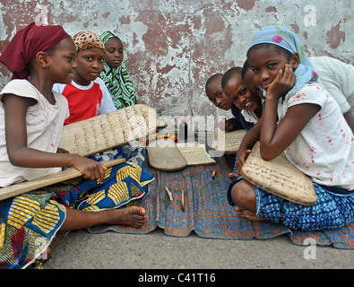 Girls learning the Quran at an islamic street school in Abidjan, Ivory coast - Stock Photo