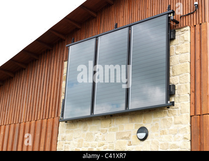 solar panels on side of new building - Stock Photo
