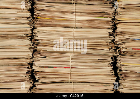 Close-up of piles of newspapers to be recycled - Stock Photo