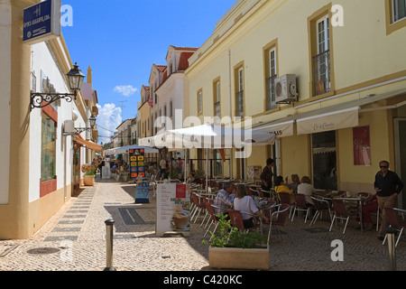 Silves, Algarve, Portugal. Narrow street with cafes and shops. - Stock Photo