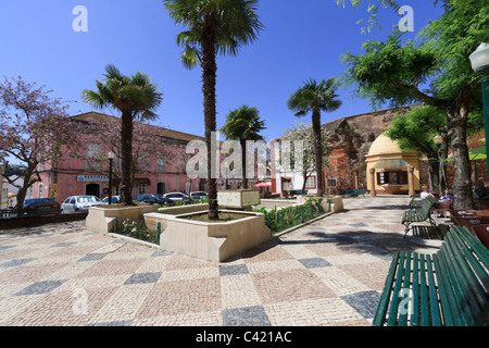 Silves Municipal Square, Algarve, Portugal. Shady square in the centre of the town with fountains and cafes. - Stock Photo