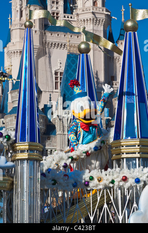 Donald Duck rides a float in 'A Dream Come True' parade at the Magic Kingdom in Disney World, Kissimmee, Florida - Stock Photo