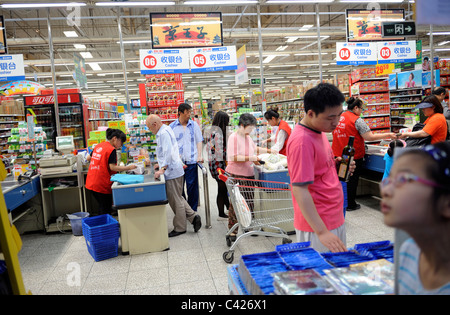 Chinese customers shopping at a Wu Mart Supermarket in Beijing, China. 28-May-2011 - Stock Photo