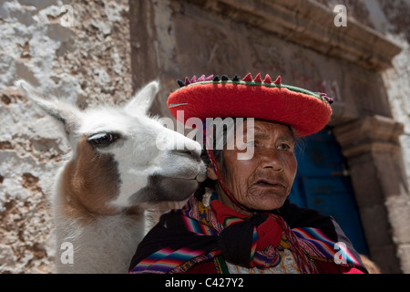 Peru, Cusco, Cuzco, Old Indian woman with llama in San Blas district. UNESCO World Heritage Site. - Stock Photo