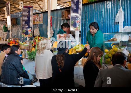 Peru, Cusco, Cuzco. Market, selling fruit juice. - Stock Photo
