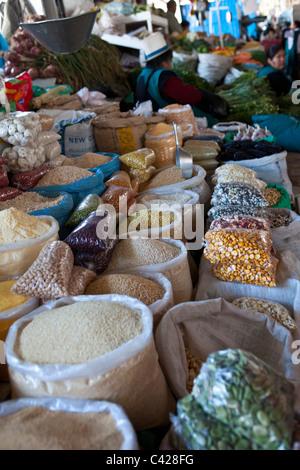Peru, Cusco, Cuzco. Market, selling cereals, beans, etc. - Stock Photo