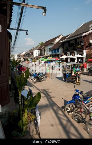 Tuk Tuk on the main high street in Luang Prabang the old Royal capital of Laos - Stock Photo