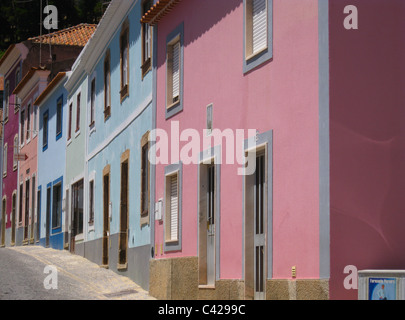 The traditional pastel blue and pink colours of Monchique houses - Stock Photo
