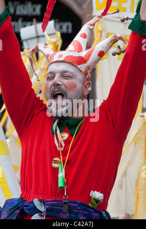 A Jester at Saint George's day celebrations in the medieval city of Chester. Cheshire, England. - Stock Photo