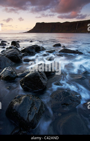 Talisker Bay on the Isle of Skye on a November evening - Stock Photo