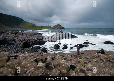 Stormy skies over the Giants Causeway on on the north Antrim Coast in Northern Island - Stock Photo