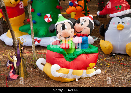 mickey and minnie mouse inflatable christmas holiday decorations in fort wilderness resort at walt disney world
