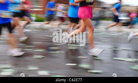 Blurring runners in a marathon running race, during the Ottawa Race Weekend. - Stock Photo
