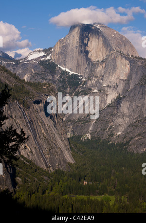 Aerial vertical panorama view of Yosemite valley and Half Dome landmark in Yosemite National Park, blue sky background - Stock Photo