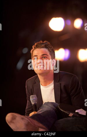 2009 X Factor winner Joe McElderry is interviewed on stage at Glasgow's 'Glam in the City' event - Stock Photo