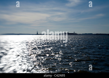 Statue of Liberty in the distance - Stock Photo