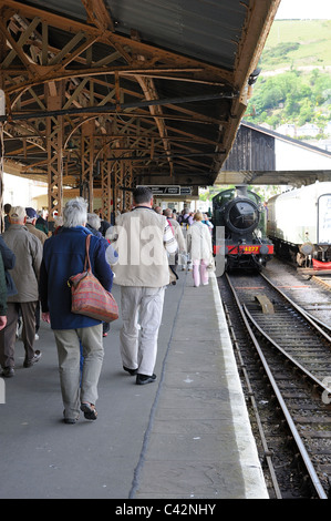Passengers walking along the platform at kingswear station after arriving from Paignton devon england uk - Stock Photo