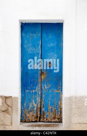 Blue wood door Mediterranean architecture Ibiza Balearic Islands - Stock Photo