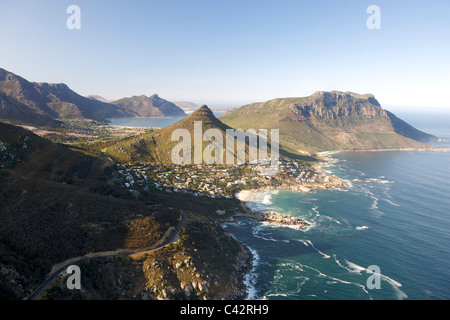 Aerial view of Cape Town's Atlantic coastline showing the suburbs of Llundudno (centre) and Hout Bay (background). - Stock Photo