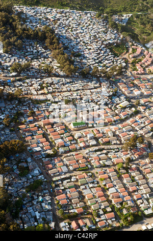 Aerial view of Imizamo Yethu township (aka Mandela Park) in Hout Bay in Cape Town, South Africa. - Stock Photo