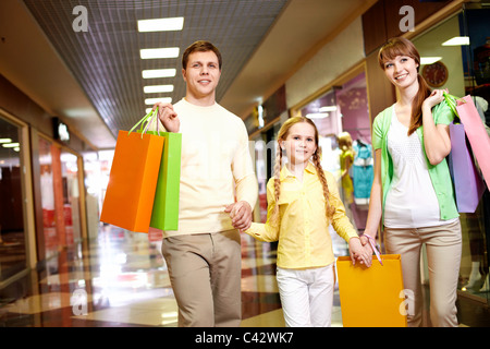 Image of family spending their time in the mall - Stock Photo