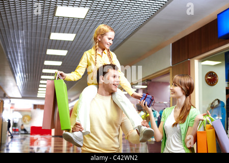Image of family with paperbags and giftbox in the mall - Stock Photo