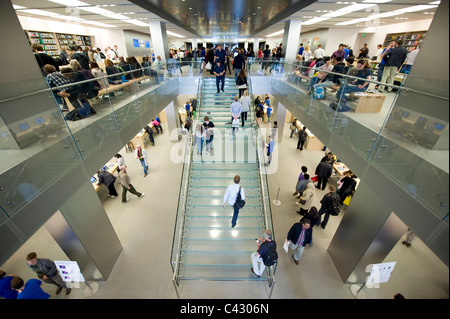 The indoor atrium of the electronics retailer Apple on Regent Street, London. (Editorial use only). - Stock Photo