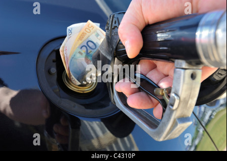 Banknotes in the Fuel Tank of a Car - Stock Photo