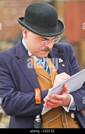 Actor at Beamish open-air museum posing as a banker, County Durham, Englad - Stock Photo