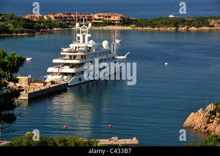 Large motor yacht in Porto Cervo harbour, Costa Smeralda, Sardinia ,Italy - Stock Photo