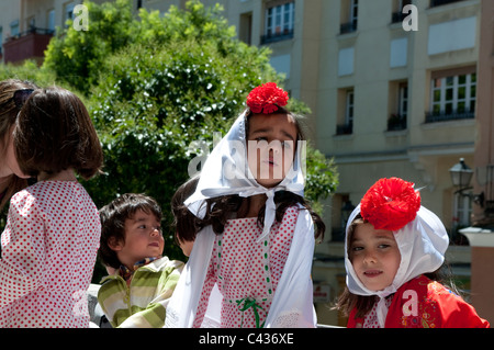 Girls dressed in chulapa - traditional costume, Plaza de la Corrala in Lavapies, Madrid, Spain - Stock Photo