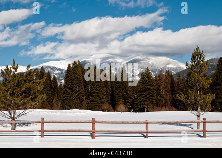 Snow covers the golf course in Seeley Lake, Montana. - Stock Photo