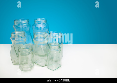 group of empty clear glass bottles - Stock Photo