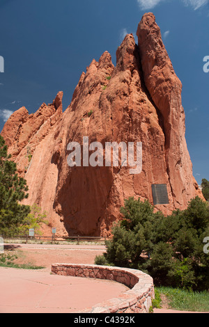 Signature Rock with its dedicatory plaque, in Garden of the Gods Park, Colorado Springs, CO - Stock Photo