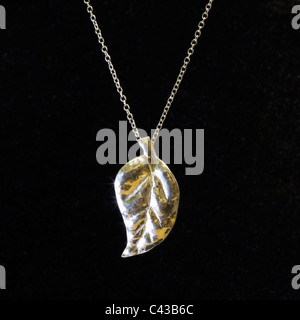 Handmade silver artisan fashion jewellery of a single leaf necklace - made in Dorset ,UK by silversmith artist Alice - Stock Photo