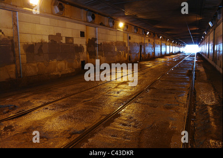 Tram rails in the shined tunnel, Moscow, Russia - Stock Photo