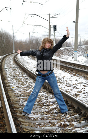 The girl on rails in the winter, Moscow, Russia - Stock Photo