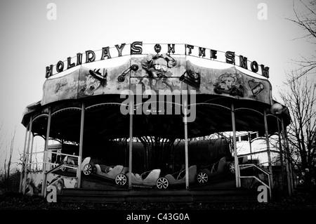 Abandoned carousel in abandoned amusement park - Stock Photo