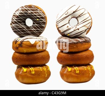 Pile of delicious chocolate and vanilla donuts in white background - Stock Photo