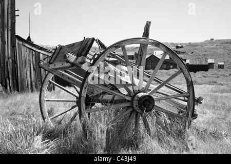 Old abandoned wagon in Bodie State Historic park in California - Stock Photo