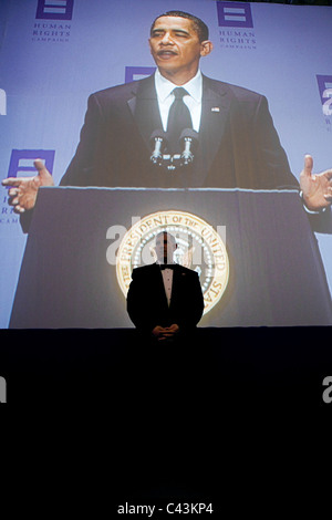 A United States Secret Service agent watches over the crowd, as President Barack Obama delivers remarks Human Rights - Stock Photo