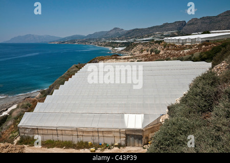 Plasticulture, plastic green houses, spreading along the coast between Mirtos and Sidonia in south eastern Crete, - Stock Photo