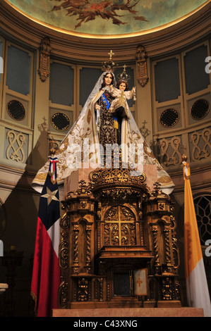 Circular interior Side Chapel Virgin Mary holding Infant Christ above gold altar flags, Metropolitan Cathedral, - Stock Photo