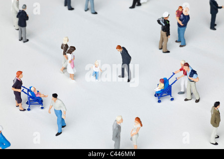 A group of miniature figurines - Stock Photo