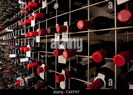 Bottles of wine in a cellar - Stock Photo